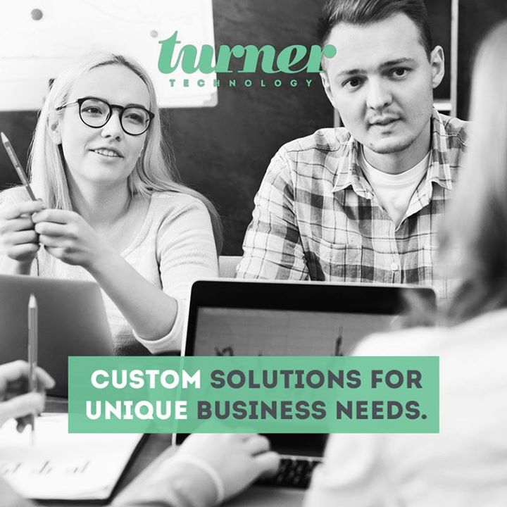 woman and man looking across a table ad another woman | Turner Technology provides custom solutions for unique business needs